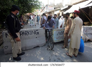 PESHAWAR, PAKISTAN - JUL 01: Commuters facing inconvenience due to smart lockdown, as a preventive measures against the spread of the coronavirus (COVID-19), on July 1, 2020 in Peshawar.