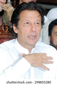 PESHAWAR, PAKISTAN - JUL 22: Tehreek-e-Insaf (PTI) Chairman, Imran Khan addresses to media person during press conference at CM House in Peshawar on Wednesday, July 22, 2015.