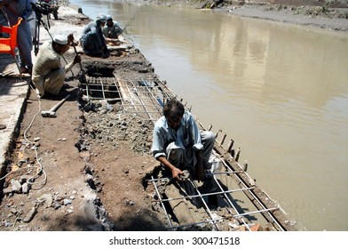 PESHAWAR, PAKISTAN - JUL 27: View of destruction at flood affected area while heavy flood water flowing area after heavy downpour of monsoon season, on July 27, 2015  in Peshawar.