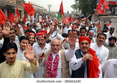 PESHAWAR, PAKISTAN - JUN 10: Supporters and leaders of different nationalist parties are protesting against ranging in local government election during rally held on June 10, 2015 in Peshawar.