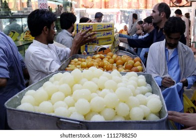 PESHAWAR, PAKISTAN - JUN 14: Peoples buying Sweets for Eid-ul-Fitar as going back to their villages to spend Eid holidays with their families, on June 14, 2018 in Peshawar.