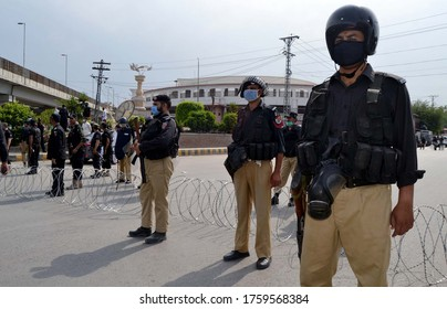 PESHAWAR, PAKISTAN - JUN 19: Police staffs block a major road lead toward Khyber Pakhtunkhwa Assembly building during many protest against price hiking on June 19, 2020 in Peshawar.