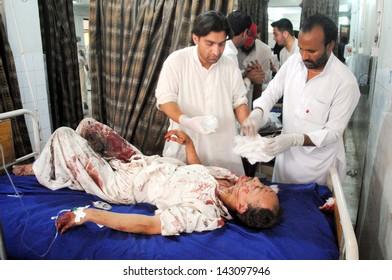 PESHAWAR, PAKISTAN - JUN 21: Victim of suicide bomb blast at Hussaini Madrassa  Chamkini area being admitted for treatment at Lady Reading hospital, on June 21, 2013 in Peshawar.