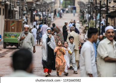 Peshawar, Pakistan - June 09, 2018: Pakistanian Family with Children in the Traditional Clothers on the Street