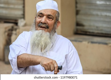 Peshawar, Pakistan - June 09, 2018: Old Pakistanian Man in the Traditional Clothers  sitting on the Street