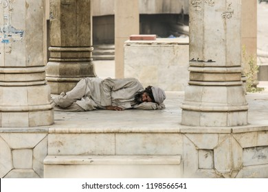 Peshawar, Pakistan - June 09, 2018: Poor Man leaning on the Mosque floor