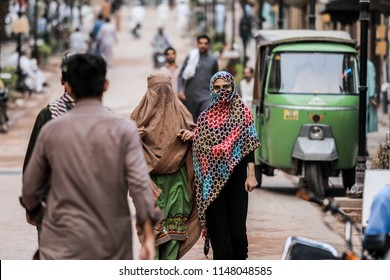Peshawar, Pakistan - June 10, 2018: Two Pakistani Women in Traditional Clothes