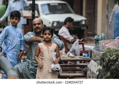 Peshawar, Pakistan - June 10, 2018:  Pakistanian People walking on the Street