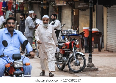 Peshawar, Pakistan - June 10, 2018:  Pakistanian Old Man walking on the Street