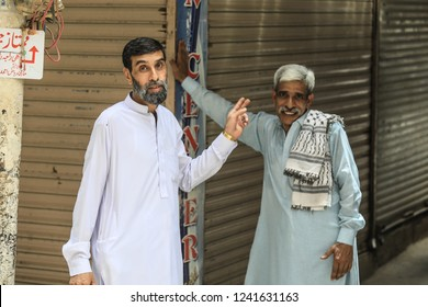 Peshawar, Pakistan - June 10, 2018: Two Adult Pakistanian Men on the Street