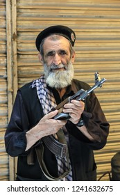 Peshawar, Pakistan - June 10, 2018: Old Man with the Gun in Black Clother