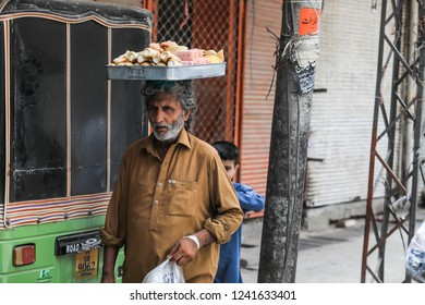 Peshawar, Pakistan - June 10, 2018: Old Man selling sweets on the Streets