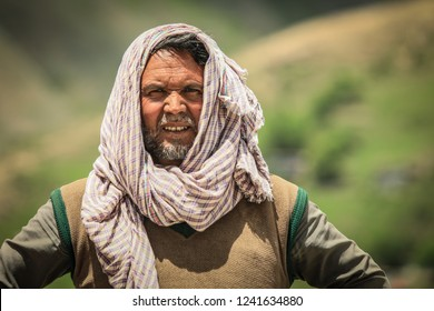 Peshawar, Pakistan - June 10, 2018: Local Man tending sheep