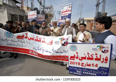 PESHAWAR, PAKISTAN - MAR 14: Participants pass through a road during awareness- raising walk about Kidneys Disease arranged by IKGW on the occasion of World Kidney Day, on March 14, 2019 in Peshawar.