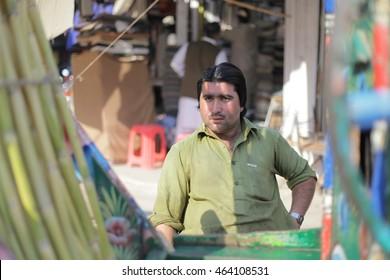 PESHAWAR, PAKISTAN - May 15: Young man sell sugar cane juice in peshawar, on 15 May, 2016 Peshawar
