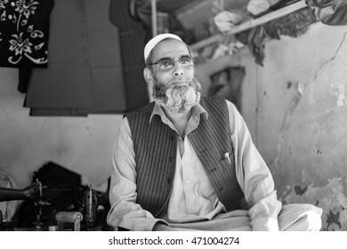 PESHAWAR, PAKISTAN - May 15:Old man his wait for his Custamor in tailer Shop peshawar, on 15 May, 2016 Peshawar