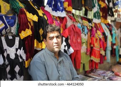 PESHAWAR, PAKISTAN - May 24: Afghan man sell out a child cloths in Peshawar, on 24 May, 2016 Peshawar