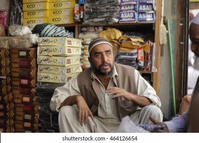 PESHAWAR, PAKISTAN - May 24: man wait for his customers to sell a Local Cloths in Peshawar, on 24 May, 2016 Peshawar