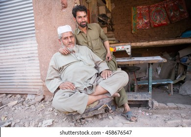 PESHAWAR, PAKISTAN - May 24: An old man has happy angry but has mechanic student was happy in Mechanics shop, on 24 May 2016 Peshawar