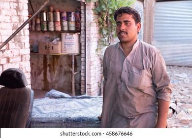 PESHAWAR, PAKISTAN - May 24: This man is expert of heavy mechine like Track Painting., on 24 May, 2016 Peshawar