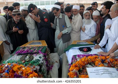 PESHAWAR, PAKISTAN - MAY 25: People attend funeral prayer ceremony of Frontier  Constabulary (FC) officials, who were killed in a firing incident on Ring Road on May 25, 2016 in Peshawar.
