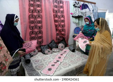 PESHAWAR, PAKISTAN - MAY 26: Visitors take keen interest at stall during Readymade  Garments Exhibition organized by KP Small Industrial Development Board, at Kohat road  on May 26, 2021 in Peshawar.