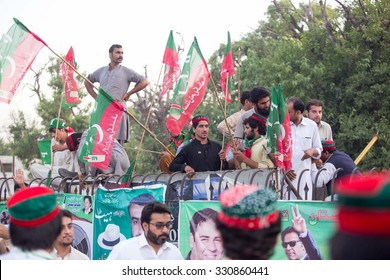 PESHAWAR, PAKISTAN - May 27, 2015: Tehreek-e-Insaf (PTI) Chairman, Imran Khan addresses to public meeting held at Shahi Bagh in Peshawar.A party worker is waiting for imran khan