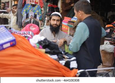PESHAWAR, PAKISTAN - may: Afghan Man sell local Handy craft on road Peshawar, on 27 may, 2015 Peshawar