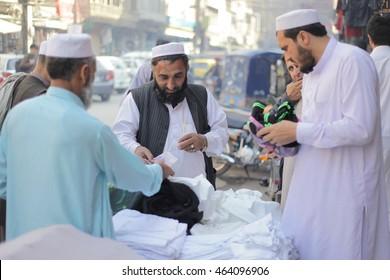 PESHAWAR, PAKISTAN - may: People buying a local Garments in Qissa Khawani bazar Peshawar, on 27 may, 2015 Peshawar