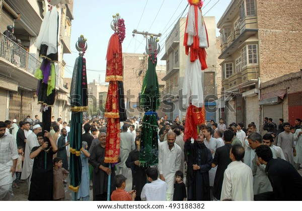 PESHAWAR, PAKISTAN - OCT 04: Shiite Muslims mourn participate in religious mourning  procession in account of 2nd Muharram-ul-Haram, pass through at a road on October 04, 2016 in Peshawar.
