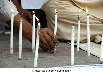 PESHAWAR, PAKISTAN - SEP 21: People lighting candles during a demonstration to present tribute to the martyrs an attack by militants on Pakistan Air Force Camp on September 21, 2015.
