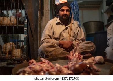 PESHAWAR, PAKISTAN - Sept 27 ,2017:  butcher is selling chiken meat27 Sept, 2017 Peshawar