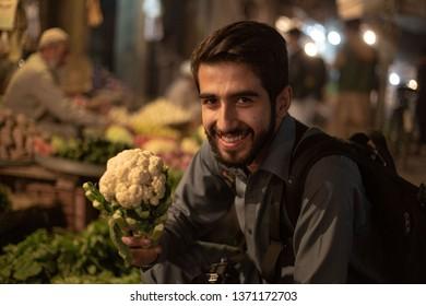 PESHAWAR, PAKISTAN - Sept 27 ,2017:  young boy is smiling in camera 27 Sept, 2017 Peshawar