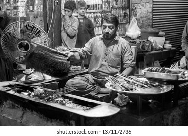 PESHAWAR, PAKISTAN - Sept 27 ,2017:  local fast food vendor is busy in Bar B que 27 Sept, 2017 Peshawar