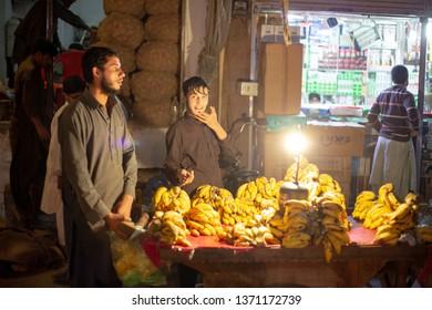 PESHAWAR, PAKISTAN - Sept 27 ,2017:  local vendor in night selling Banana 27 Sept, 2017 Peshawar