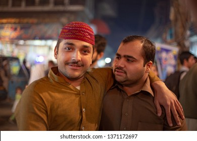 PESHAWAR, PAKISTAN - Sept 27 ,2018:  in local market two best freiends are psoing for picture27 Sept, 2018 Peshawar