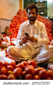PESHAWAR, PAKISTAN - Sept 27 ,2018 :  local vendor is selling tomato 27 Sept, 2017 Peshawar