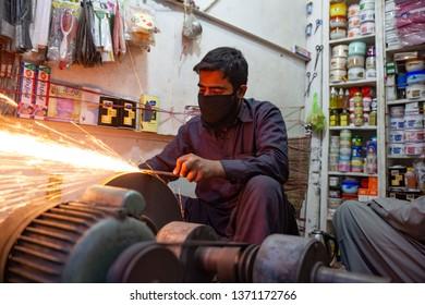 PESHAWAR, PAKISTAN - Sept 27 ,2018:  local smith is sharping knife  27 Sept, 2018 qissa khwani Peshawar