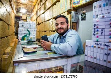 PESHAWAR, PAKISTAN - Sept 27 ,2018:  botton vendor is smiling in camera 27 Sept, 2018 qissa khwani Peshawar
