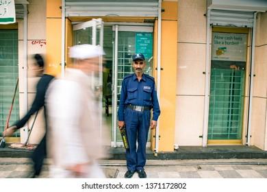 PESHAWAR, PAKISTAN - Sept 27 ,2018:  security is standing still while people pass away  27 Sept, 2018 qissa khwani Peshawar