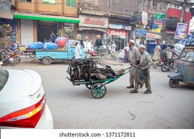 PESHAWAR, PAKISTAN - Sept 27 ,2018:  mechainics are pulling huge truck engine in road side 27 Sept, 2018 qissa khwani Peshawar