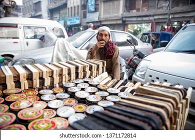 PESHAWAR, PAKISTAN - Sept 27 ,2018:  local vendor is selling shoe polish 27 Sept, 2018 qissa khwani Peshawar