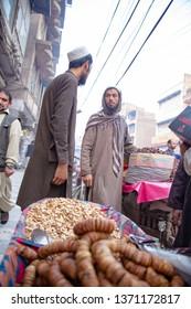 PESHAWAR, PAKISTAN - Sept 27 ,2018:  dry fruit dealer is talking with each other 27 Sept, 2018 qissa khwani Peshawar