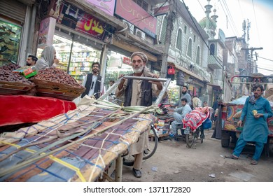 PESHAWAR, PAKISTAN - Sept 27 ,2018:  serior hard worker is pulling two Wheeler long car27 Sept, 2018 qissa khwani Peshawar
