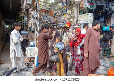 PESHAWAR, PAKISTAN - Sept 27 ,2018:  female beggars are passing from local shop  27 Sept, 2018 qissa khwani Peshawar