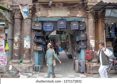 PESHAWAR, PAKISTAN - Sept 27 ,2018:  local vendor places bags on small gate of market 27 Sept, 2018 qissa khwani Peshawar