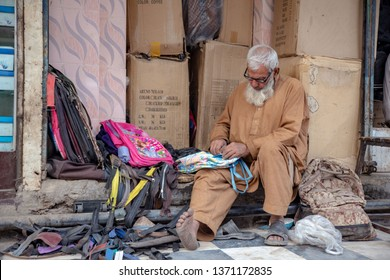 PESHAWAR, PAKISTAN - Sept 27 ,2018:  local cobbler is fixing school bags  27 Sept, 2018 qissa khwani Peshawar