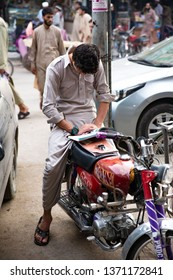 PESHAWAR, PAKISTAN - Sept 27 ,2018:  school boy is reading book while waiting for is father 27 Sept, 2018 qissa khwani Peshawar