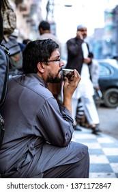 PESHAWAR, PAKISTAN - Sept 27 ,2018:  a person is taking green tea in middle of bazar 27 Sept, 2018 qissa khwani Peshawar