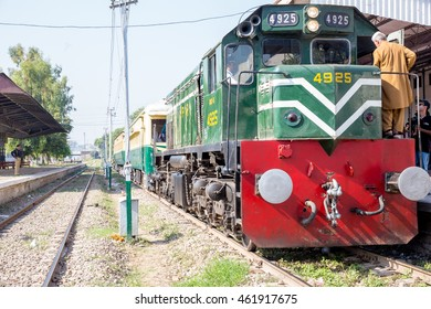 PESHAWAR, PAKISTAN -  Sept 27: a view of Pakistan Rail, KPK government arrange it for Azadi Train event for Peoples and a Old man strating engine, on 27  Sept, 2015 Peshawar